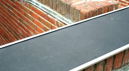 RubberGuard Mat on Brick Wall